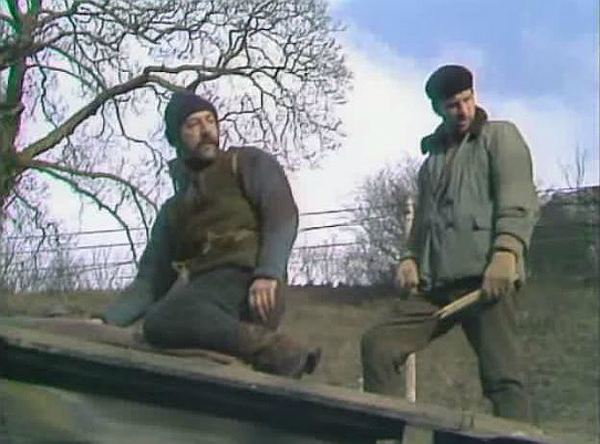 Sanders and Jim - repairing the roof - in Mad Dog
