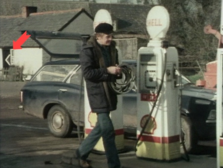 Greg crosses the garage forecourt to fuel-up a second vehicle for Abby